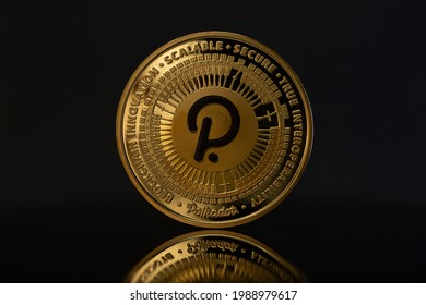 Polkadot DOT Cryptocurrency physical coin placed on reflective surface in the dark background