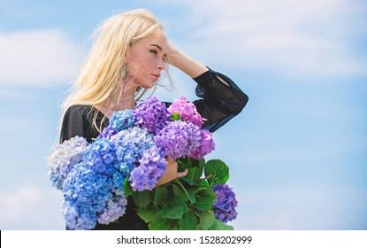 Pollen allergy. Springtime bloom. Female adore flowers. Spring attributes. Enjoy spring without allergy. Allergy free life. Stop allergy blooming season. Girl tender blonde hold hydrangea bouquet.