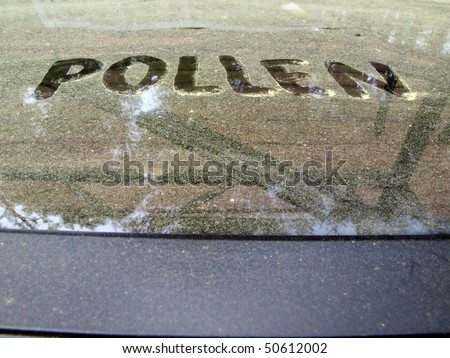 a pollen covered table during the beginning of the Spring season with the word written on it.