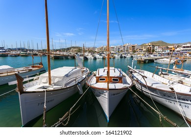 POLLENCA PORT, MAJORCA: APRIL 15: traditional llaut boats anchored in port on sunny day on 15 April 2013 on Majorca island.