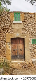 POLLENSA, MALLORCA - MAY 21, 2018:  Old ruined house on the steps to Calvary Church. The historic old town of Pollensa, Mallorca is a popular tourist destination.