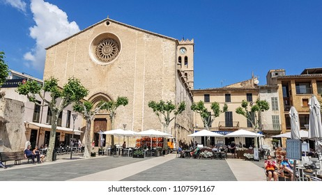 POLLENSA, MALLORCA - MAY 22,2018: The Major Plaza of Pollenza. The historic old town of Pollensa, Mallorca is a popular tourist destination.
