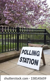 Polling station sign on pavement