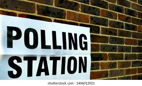 Polling station sign on wall during UK elections
