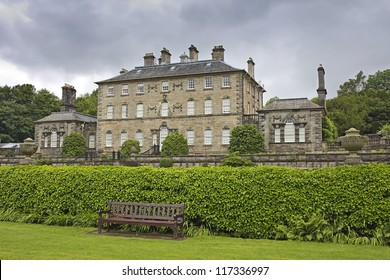 Pollok house with bench in foreground. The house is situated in Pollok Park near Glasgow, Scotland, UK.