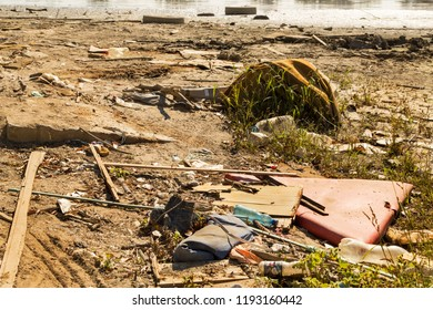 Polluted river bank by some random trash making huge ecological problem in Serbia