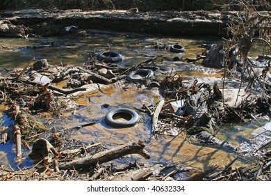 Polluted river bed full of junk that should not be.