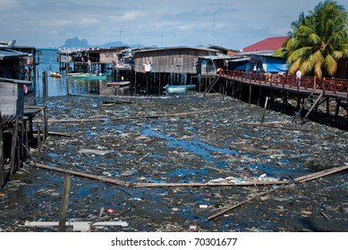 Polluted town in Malaysia, garbage near the houses