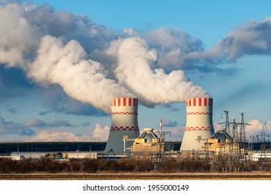 Polluting air of Nuclear power plant with Cooling tower with steam of Atomic power station. Industrial zone of nuclear with emission of steam in the atmosphere