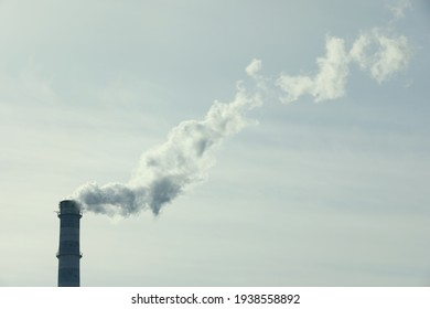 Polluting air with smoke from industrial chimney outdoors, space for text. CO2 emissions