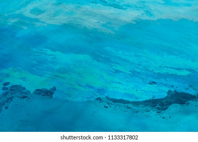 Polluting oil slick floating on water