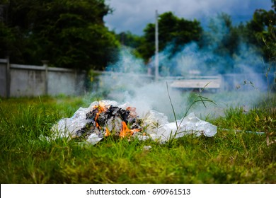 Pollution from burning waste at open area , waste from household , environment concept.