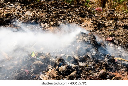 Pollution from burning waste at open dump site