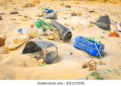 Pollution concept with detail of plastic bottles on the beach