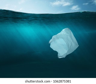 Pollution concept. Plastic bag floating in the ocean with copy space