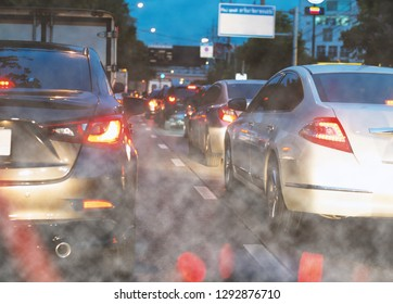 Pollution of environment by combustible gas of a car ,Row of cars with traffic jam on free way at night, rush hour