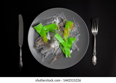pollution of food concept. salad from plastic bag and glass for lunch. ready to eat a plastic refuse on a table set. Flat lay View from above. Top view. Ban plastic