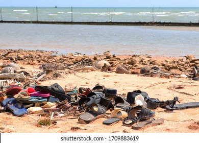Pollution: Garbages, plastic, and wastes on the beach of tropical sea. Environmental pollution. Sand beaches polluted with pieces of plastic waste.