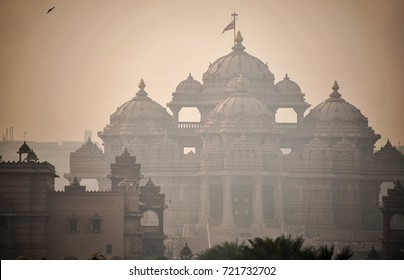 Pollution haze obscures the sun at Swaminarayan Akshardham temple complex, Delhi, India