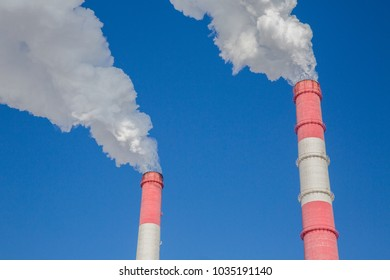 pollution of nature, pipes with smoke in the sky