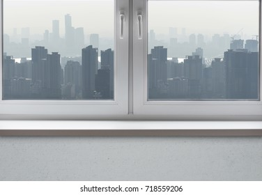 Pollution over a big Asian city, view through the clean window, conceptual picture