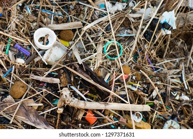 Pollution of Plastic and litter material on sand beach