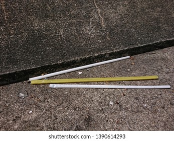 Pollution of plastic straws on the walkway roadside. The people throwing trash carelessly in anywhere not a bin. Environment negligently concept.