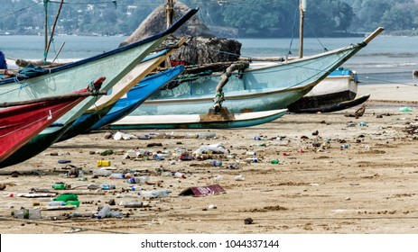 Pollution of river, sea, ocean water with waste, plastics garbage - back side of tourism and modern life. Concept of pollution of ocean and sea coastline with plastic trash. Sri Lanka