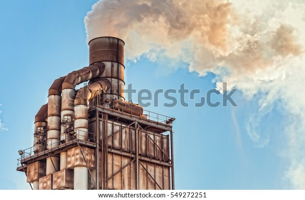 Pollution. Smoke from industrial chimney. Old smokestack of factory.