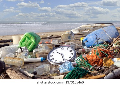 Pollution: it's time to wake up! Garbage and waste washed up on a beach. Trash beach pollution