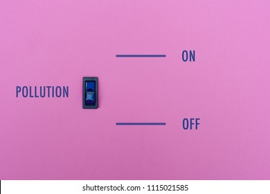 Pollution title on a pink wall with a blue symbol switch. We can stop the pollution in simple way? On/off toggle the pollution. Concept photo.
