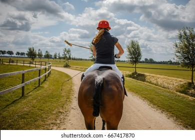 Polo Horse Riding Woman on Gravel Road, Dramatic Look on Sunny Day