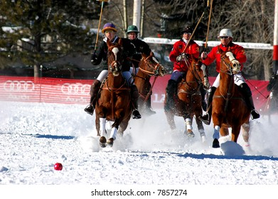 Polo players at full gallop in world championship snow polo game