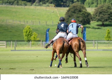 Polo scrum between two players on the field