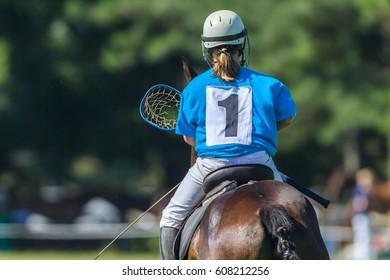 Polocrosse Teenage Girls Horses Game Polocrosse horse ponys players teenage girls unidentified equestrian sport game.