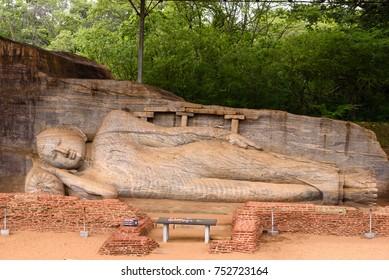 Polonnaruwa, Sri Lanka. Gal Viharaya (Rock temple) Parinirvana (Final Extinction) buddha statue in the UNESCO ruined ancient town Polonnaruwa in the cultural triangle in Sri Lanka.