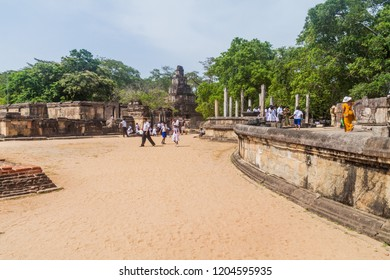 POLONNARUWA, SRI LANKA - JULY 22, 2016: Tourists visit Quadrangle temple group in the ancent city Polonnaruwa, Sri Lanka