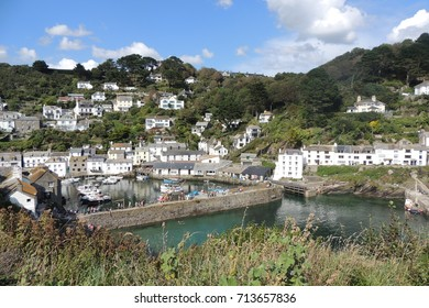 Polperro, Cornwall - the harbour from the coast path, with turquoise sea