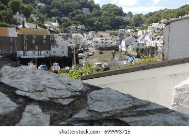 Polperro, Cornwall - a view of the harbour and white houses