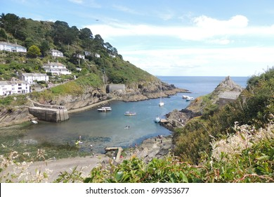Polperro, Cornwall - a view out to sea and boats from the coast path