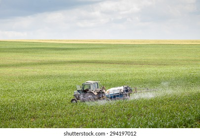Polski Trambesh - May 27: Landscape with tractor sprayer carried chemical treatment of crops against pests on May 27, 2015, Polski Trambesh, Bulgaria