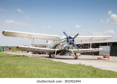 Polski Trambesh - May 30: Front plan dipteral aircraft used in agricultural aviation in grassy flat area on 30 May 2015 Polski Trambesh, Bulgaria