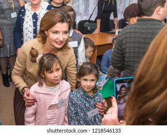 POLTAVA OBLAST , UKRAINE - 31 OCTOBER 2018: First Lady of Ukraine Maryna Poroshenko L while attending an orphanage