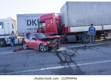 POLTAVA OBLAST, UKRAINE - Aug 29, 2014:Car accident involving a truck on the highway E40 in Poltava, Ukraine