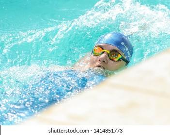 POLTAVA, UKRAINE - 1 JUNE 2019: Woman while swimming during open swimming tournament «Poltava Masters IV Championship» in the pool «Delfin»