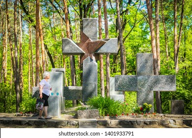 POLTAVA, UKRAINE - 19 MAY 2019: Granite crosses - monuments in place of mass shootings of people of times in the period of the Great Purge Soviet Union (1937-1938) in the natural places of the Trubu