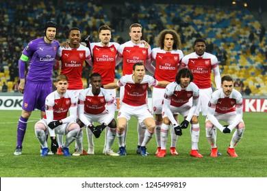 POLTAVA, UKRAINE - 29 NOVEMBER 2018: Footballers of Arsenal London while photographing during UEFA League Europe match Vorskla - Arsenal London at Vorskla Stadium