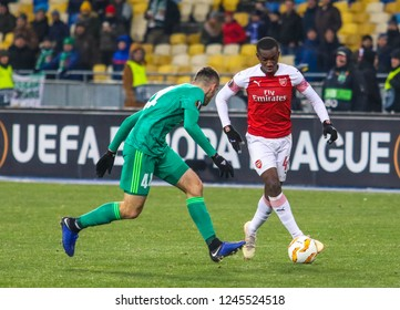 POLTAVA, UKRAINE - 29 NOVEMBER 2018: English professional footballer Eddie Nketiah (R) during UEFA League Europe match Vorskla - Arsenal London at Vorskla Stadium