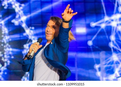 POLTAVA, UKRAINE - 9 JUNE 2018: Ukrainian singer Oleg Vinnik during his performance on stage at Oleksiy Butovsky Vorskla Stadium