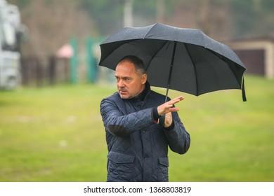 POLTAVA, UKRAINE - APRIL 11, 2019: FC Vorskla head coach Vitaliy Kosovskyi during the match of the youth teams Vorskla - Dynamo Kyiv at the Ltava stadium